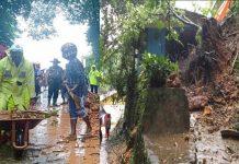 Caption : Terlihat anggota polri bersama warga saat membantu membersihkan longsor yang menutupi badan jalan dan rumah milik Hendrik Lewakabesi di Polimak III Pintu Angin, Selasa (229/03/2019) pagi.