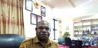 Drg. Aloysius Giyai, M.Kes