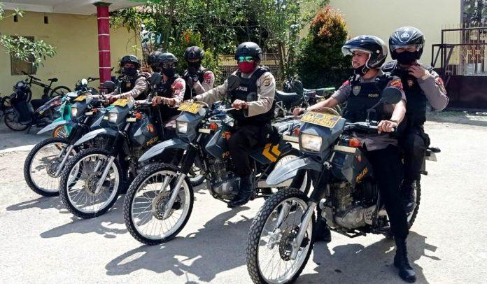Personil Unit Dalmas Polres Jayawijaya yang siap melaksanakan patroli menggunakan roda dua di seputaran Kota Wamena, Kamis (7/5/20)