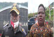 Caption : Kepala Dusun Puncak Jaya Tibenus Tabuni (Kiri), dan Ketua Forum Perempuan Peduli Pembangunan Ibu Mirena Enumbi (kanan)
